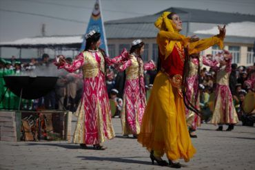 Girls in ethnic clothes dancing at Nowruz in Tajikistan