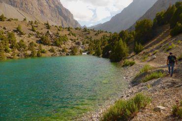 tourist hiking near lake in Tajikistan travel, Fann mountains