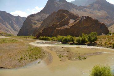 Hiking in Jisew valley - Tajikistan trekking adventure near mountians, river and beautiiful landscape