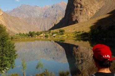 Pamir mountains hiking-girl looking to mountains in Tajikistan tour package