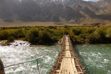 Pamir fragile bridge made of branches in Tajikistan