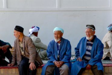 Uzbek old men in traditional clothes