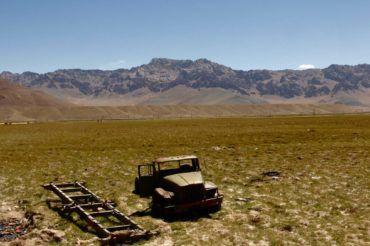 Broken Car seen in pamir - Tajikistan travel. murghab