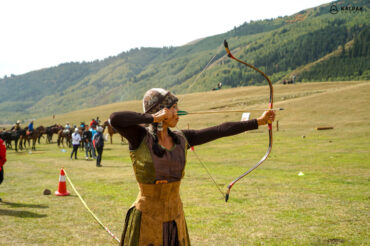 Kyrgyz girl shooting arrows and bow