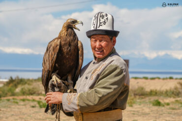 Eagle hunter with his eagle in Kyrgyzstan