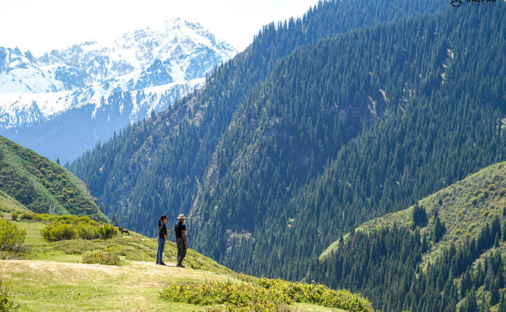Kyrgyzstan mountains view observed by standing people