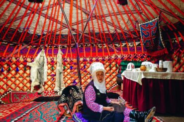 traditional yurt inside with traditional women in Kyrgyzstan