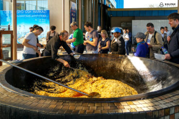 Plov cooking in huge pot in Uzbekistan