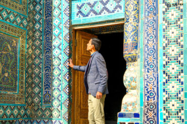 Tourist looking at blue tiles in Samarkand