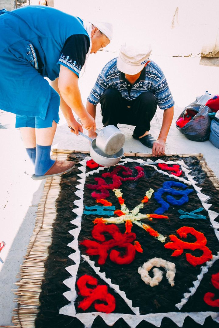 Kyrgyz felt making carpets in Kochkor
