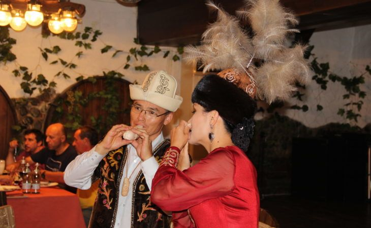 Kyrgyz people in traditional clothes playing instruments during Kyrgyzstan & Kazakhstan Tour