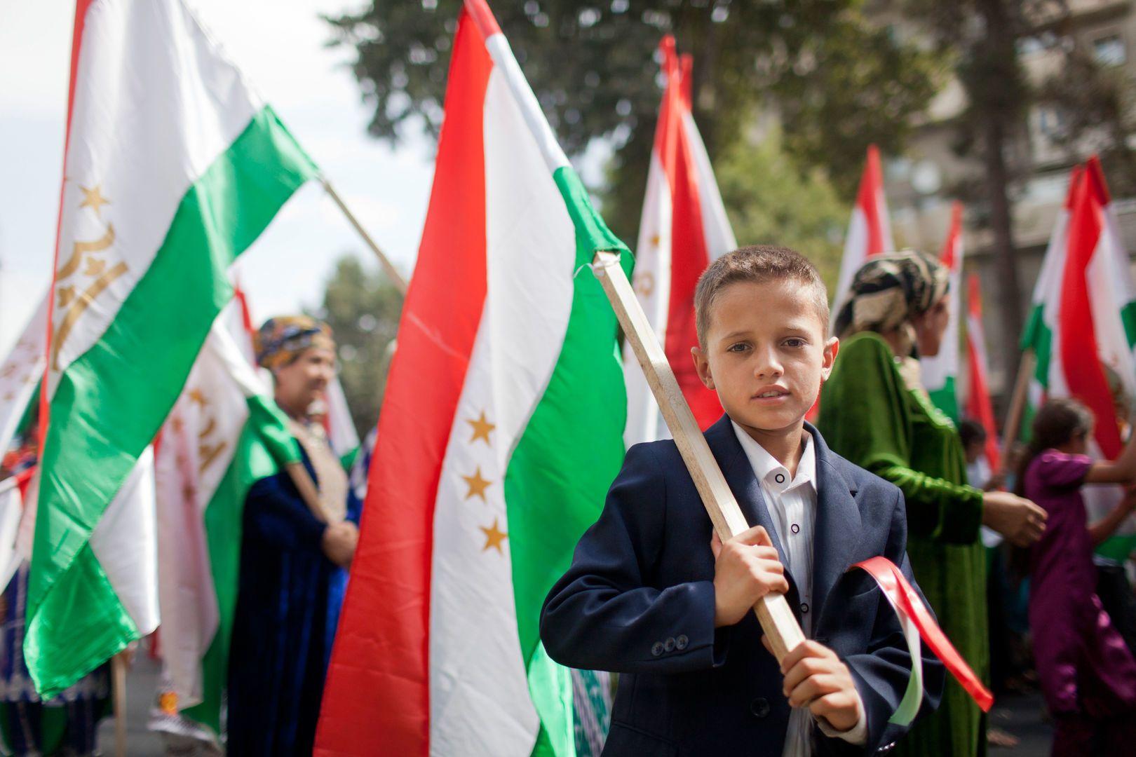 Boy holding Tajik flag at Nowruz celebration