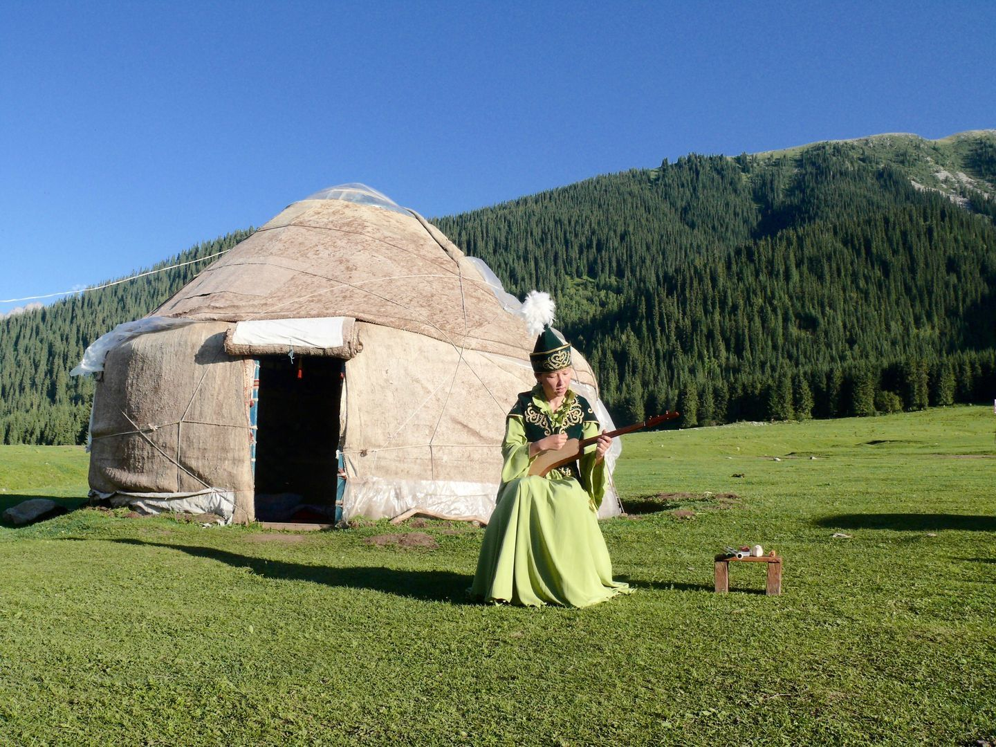 kyrgyz girl singing in fornt of the yurt