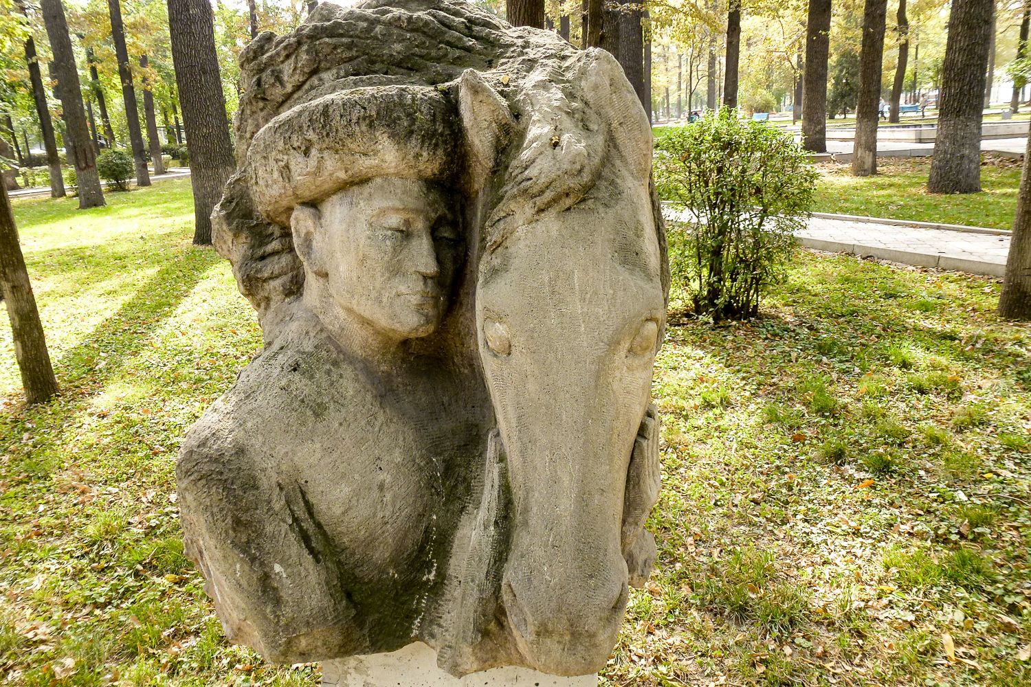 nomad with his horse sculpture in oak park in Bishkek City Tour