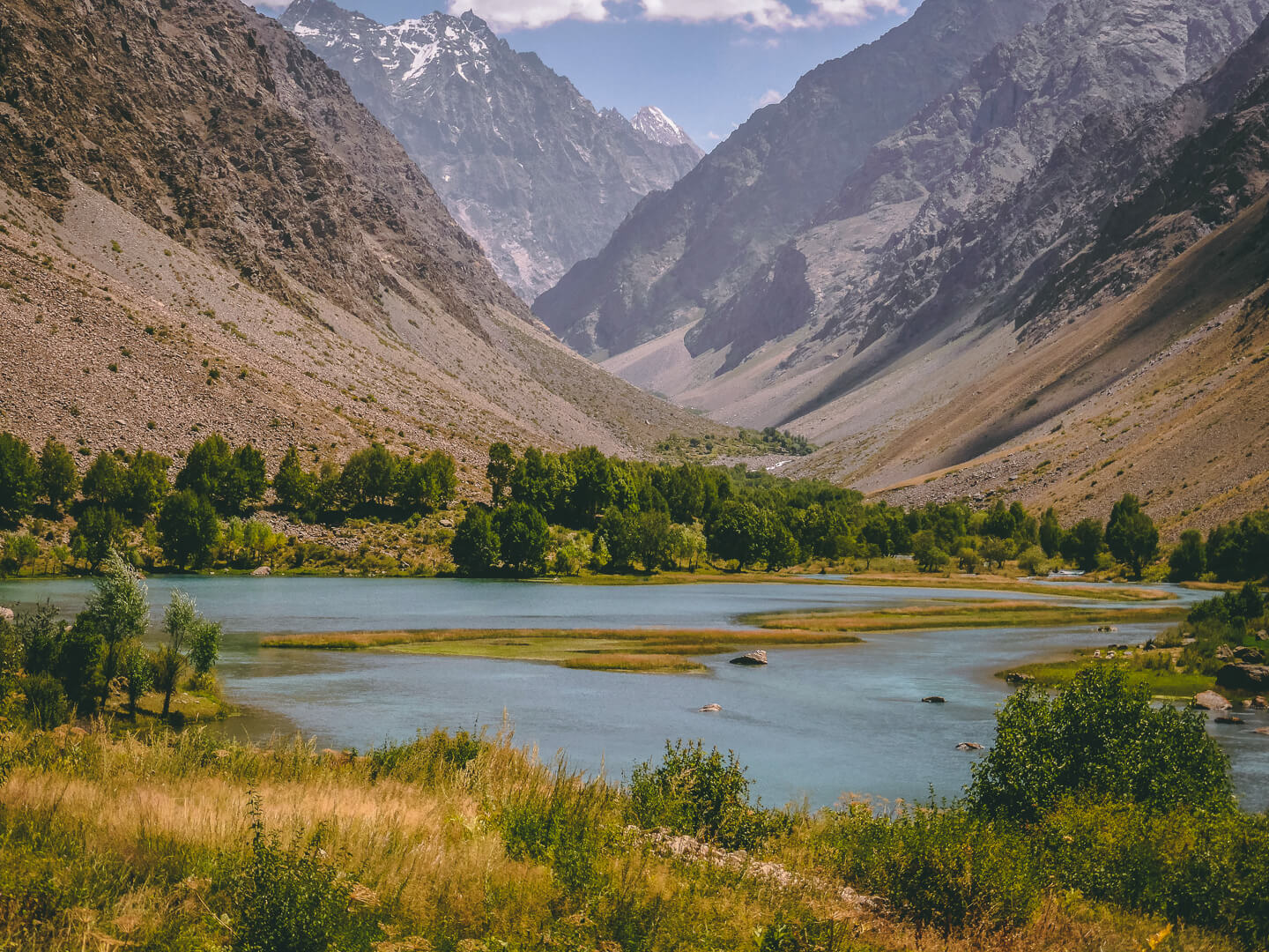 Jisev valley with mountains and lake in Pamirs