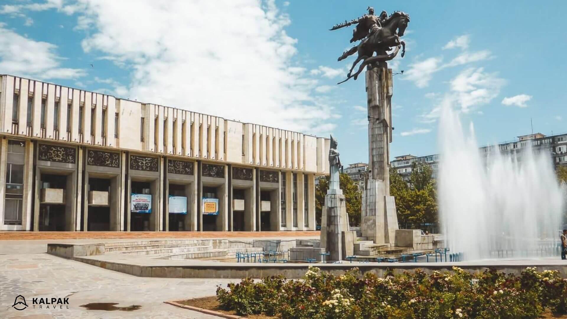 Bishkek Philharmonie with Manas statue in Kyrgyzstan