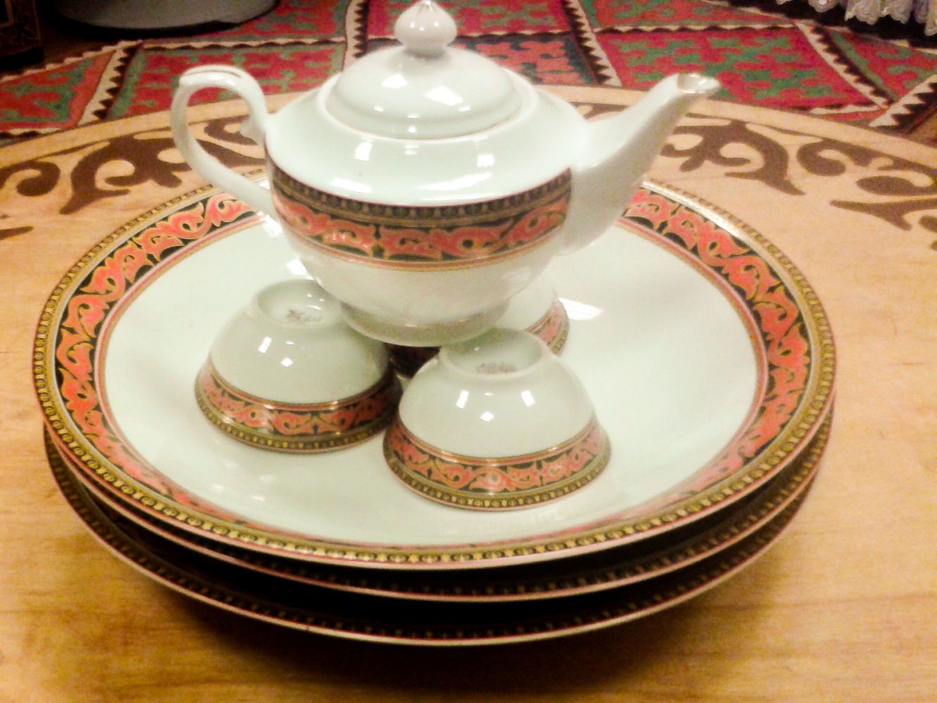 Central Asian teapot and cups with traditional design
