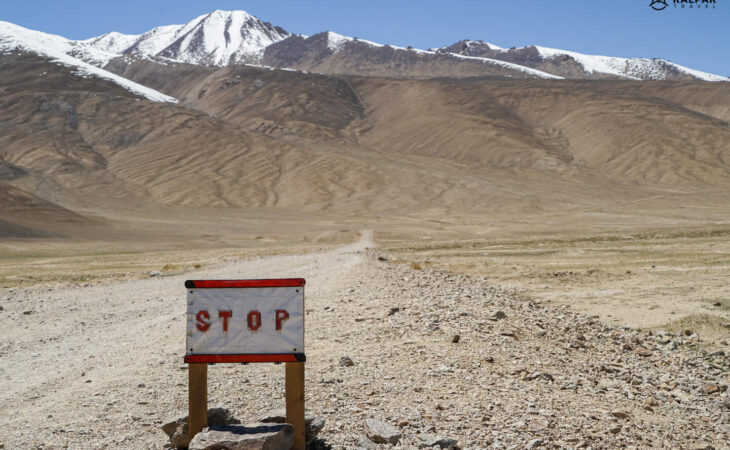 Pamir Highway stop road sign on empty way