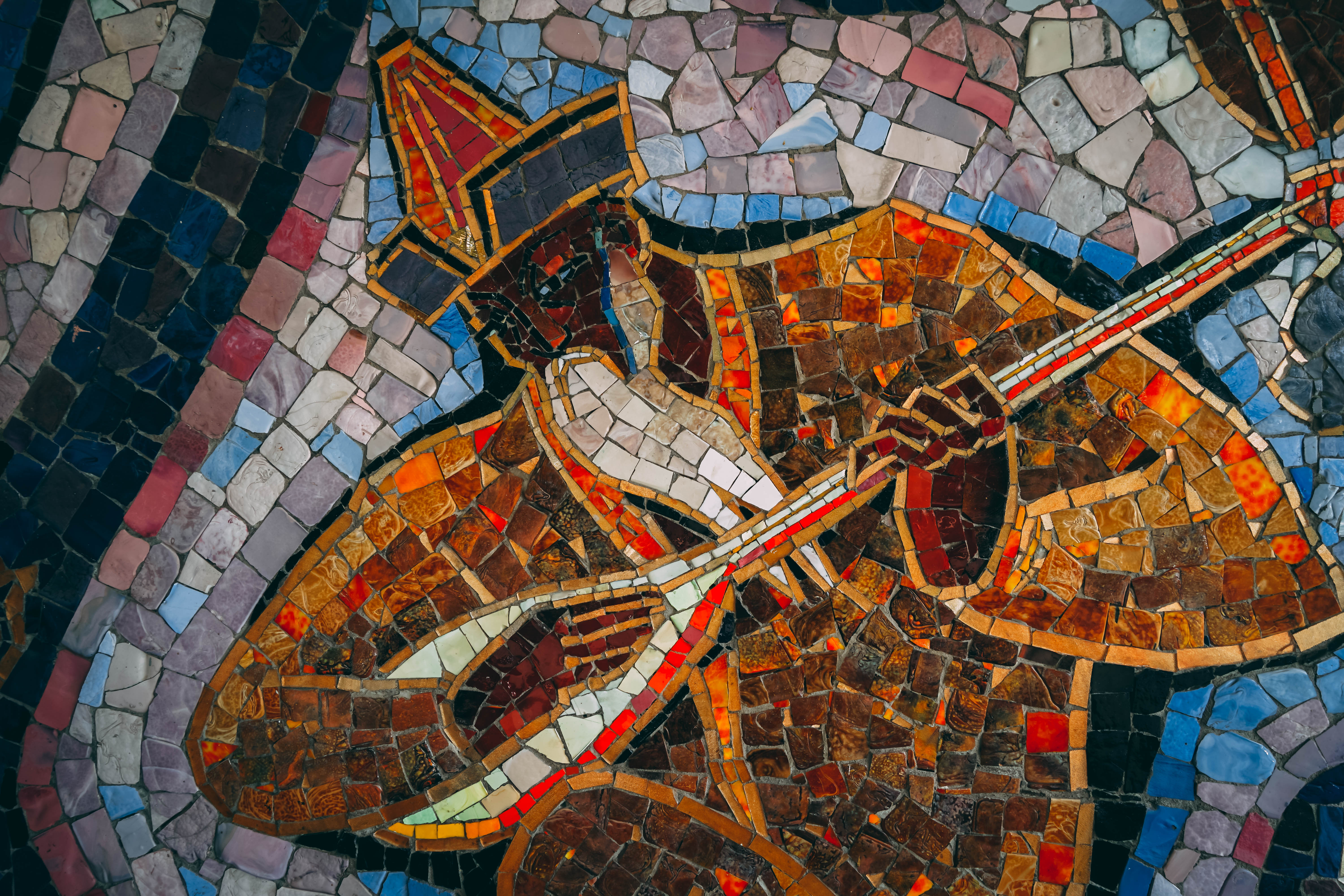 Kazakh musician with national instrument on Almaty mosaics