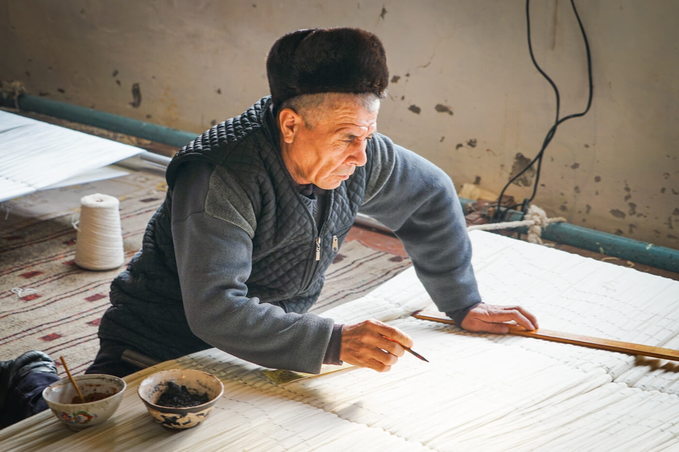 Silk maker in Fergana, Margilan silk factory