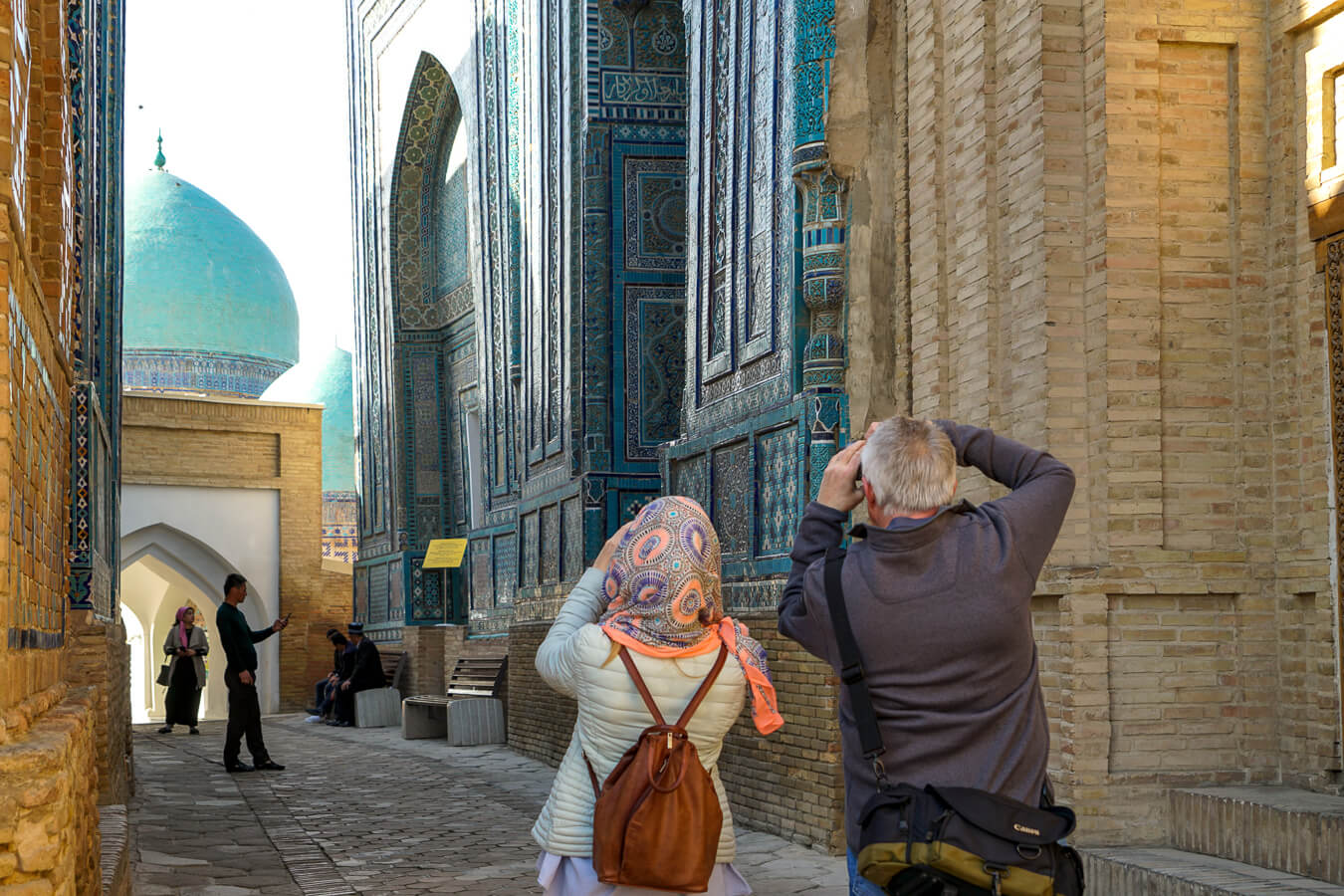 Shahizinda mausoleum photographed by tourists in Samarkand